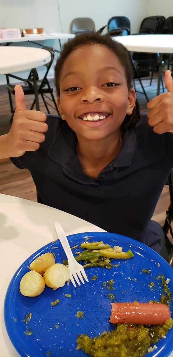 Child in the LANDers After-School Program with Lunch