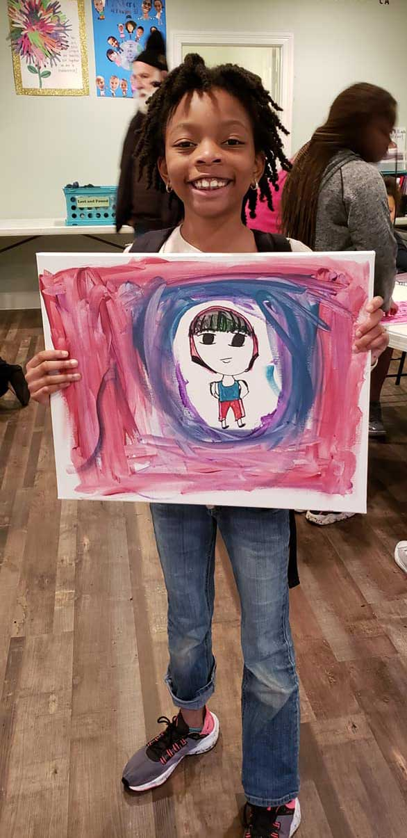 Child in the LANDers After-School Program with Her ARtwork