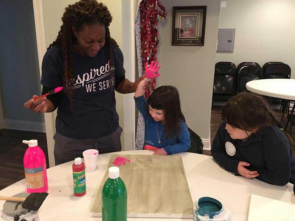 Children in the LANDers After-School Program With Paint