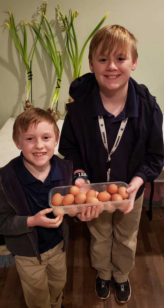 Two Children in the LANDers After-School Program With Their Eggs