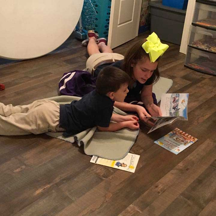 Two Children in the LANDers After-School Program Read a Book