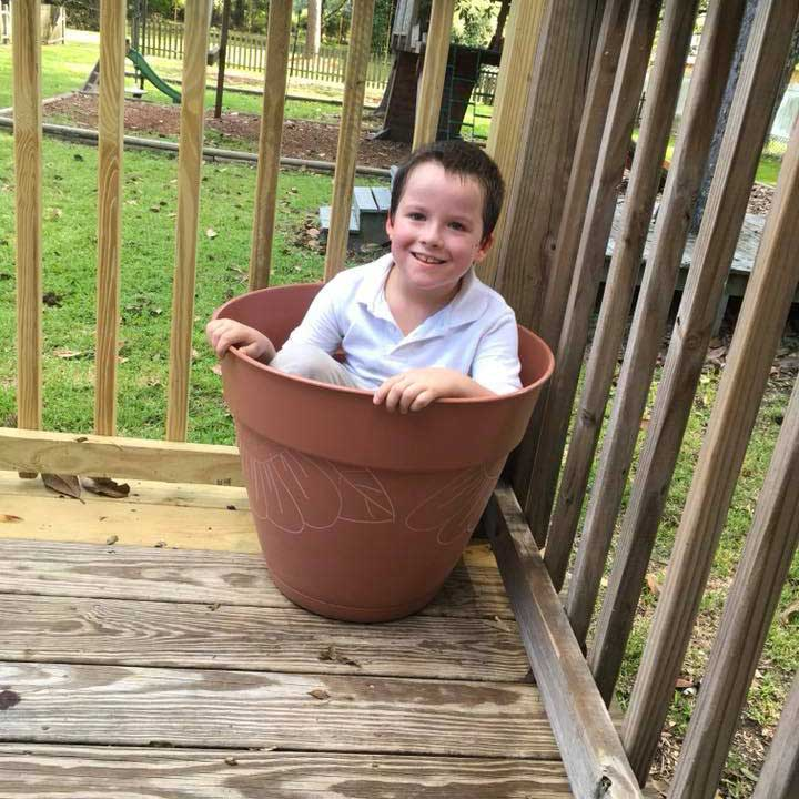 LANDers After School Child Poses in a Pot