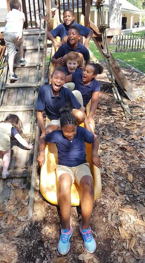 LANDers After School Kids Play on the Slide