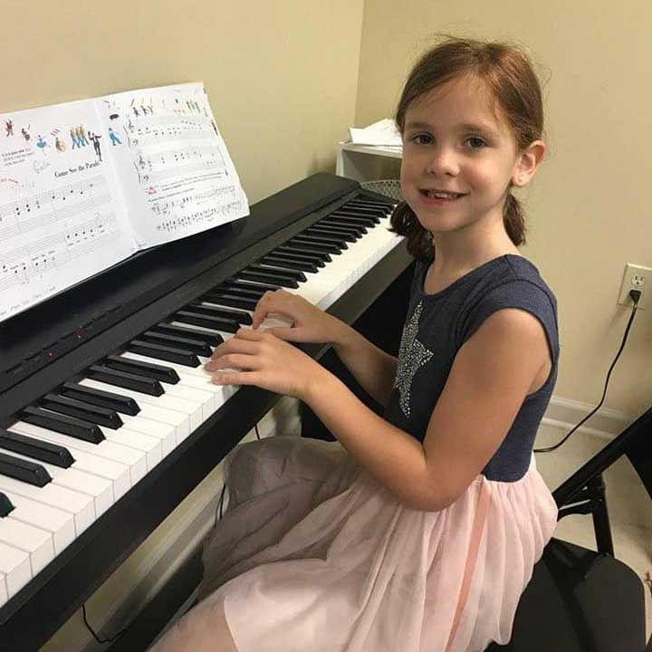 Young Girl Plays the Piano at the Young Artists' Academy