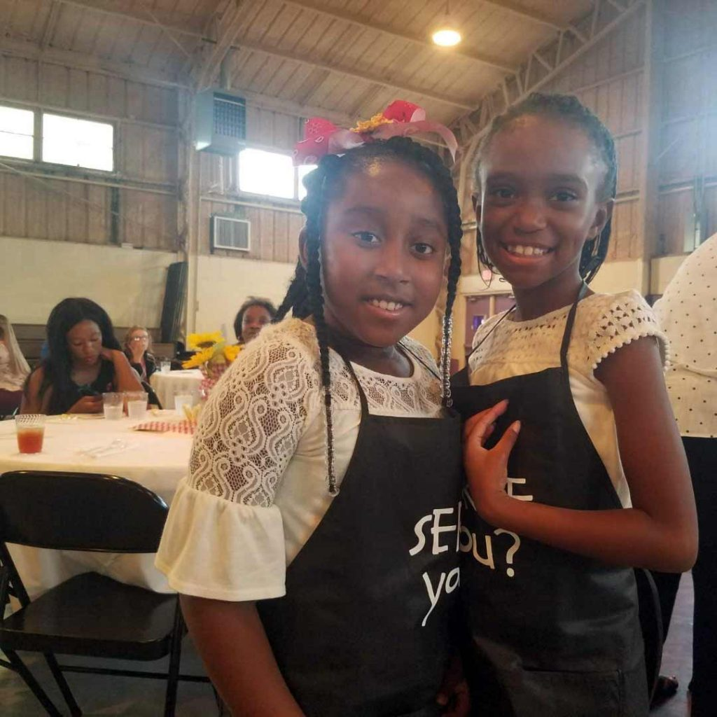 Two young girls at the Young Artists' Academy gala