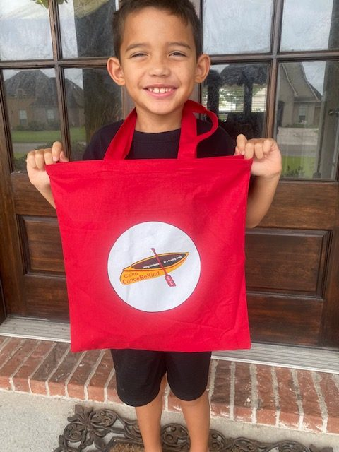 Camp Canoe-Be-Kind Camper with his red bag